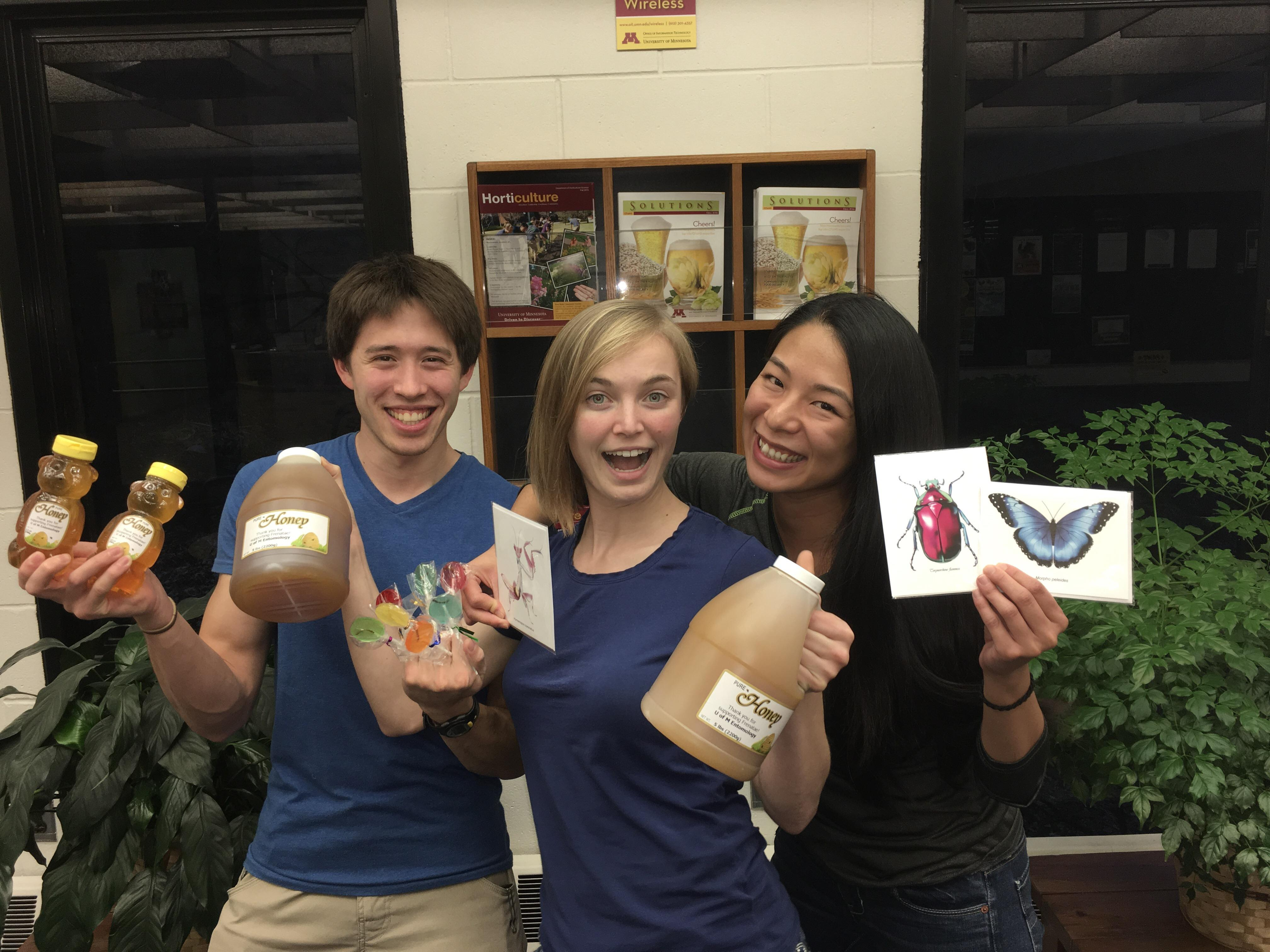Graduate students Eric Middleton (PhD, Heimpel & Macrae labs), Grace Sward (MS, Philips lab), and Anh Tran (PhD, Hutchison lab) get ready for the annual Frenatae Honey Sale!